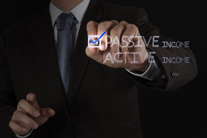 businessman hand checking  passive or acctive income as money co