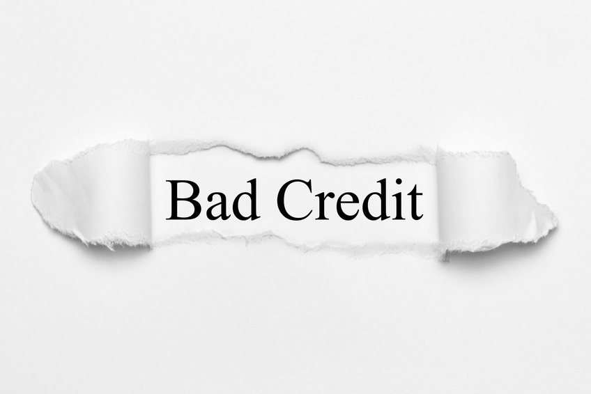 Bad Credit on white torn paper