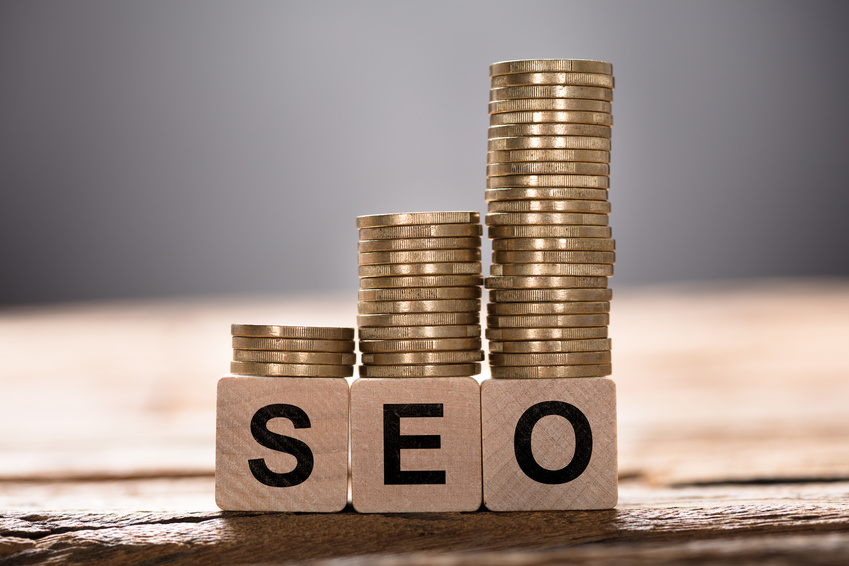 SEO Text Written On Wooden Blocks With Stacked Coins
