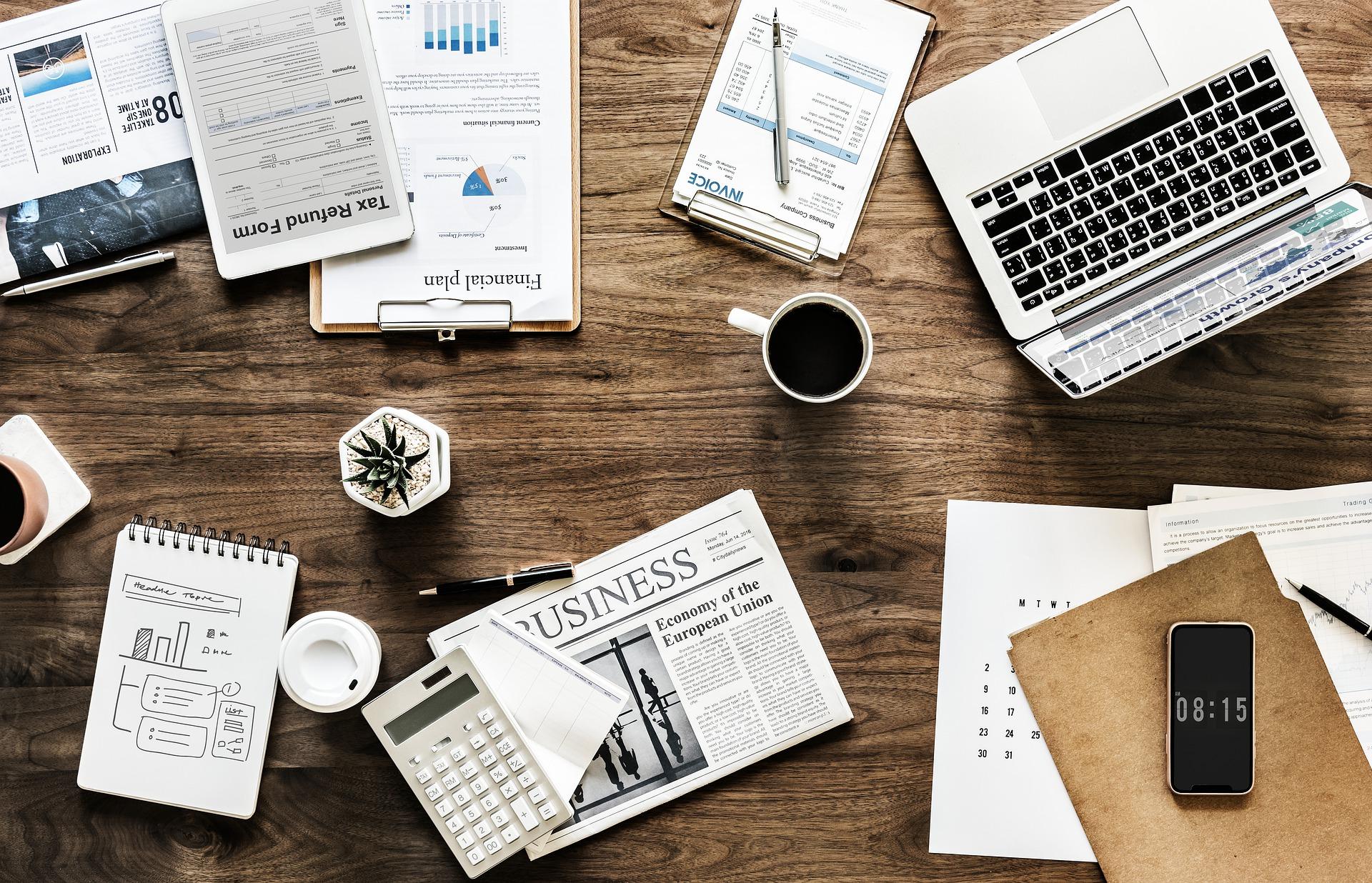 business desk laptop newspaper finance